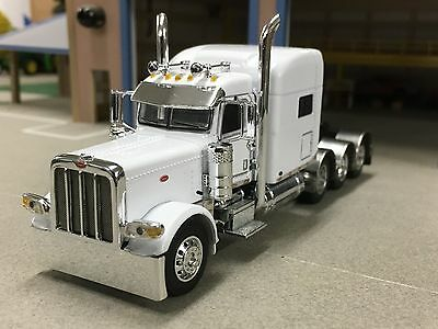 "1/64 DCP WHITE 389 PETERBILT TRI-AXLE W/ 70"" SLEEPER"