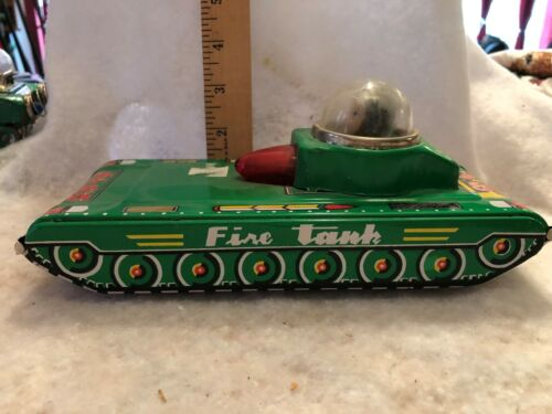 vintage space toy FRICTION OPERATED FIRE TANK WORKS WELL AND GREAT CONDITION.