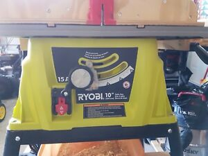 "Ryobi 10"", 15 amp table saw with stand and accessories"