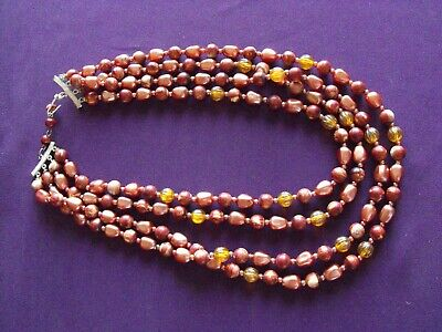 60s -70s Jewelry – Necklaces, Earrings, Rings, Bracelets 1960's Vintage multi strand necklace in brown tones $14.85 AT vintagedancer.com