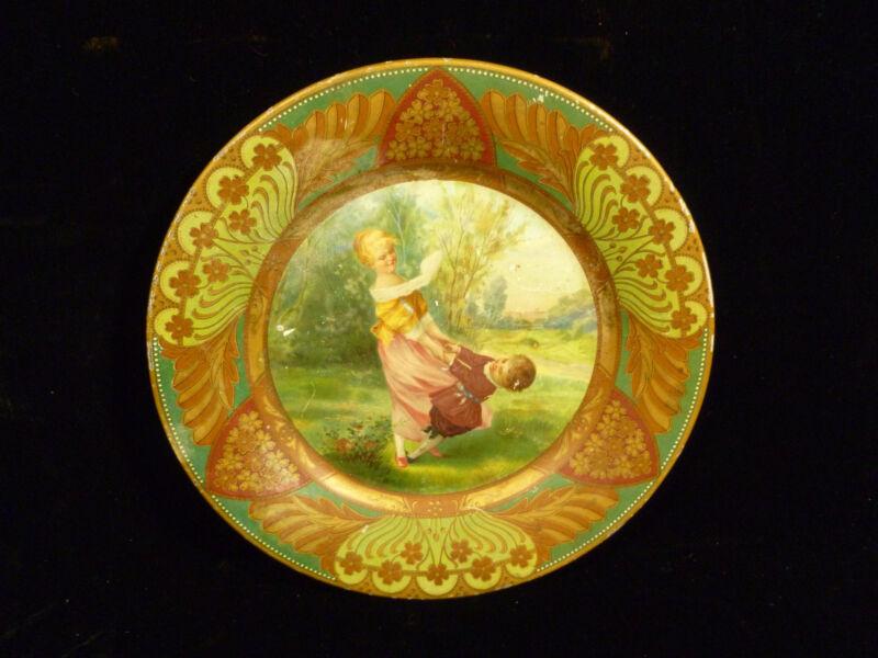 BEAUTIFUL & RARE TIN ADVERTISING PORTRAIT PLATE BOY & GIRL PLAYING – CIRCA 1910