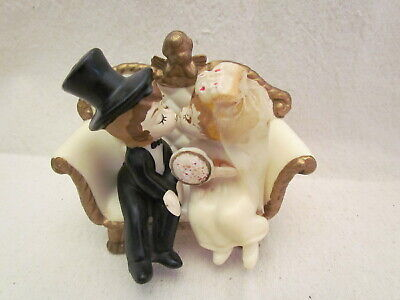 1970 Kissing Bride & Groom on Bench by Wilton Inc.