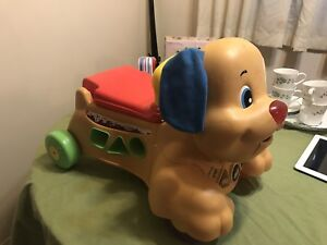 Fisher Price Laugh & Learn ride on/push toy
