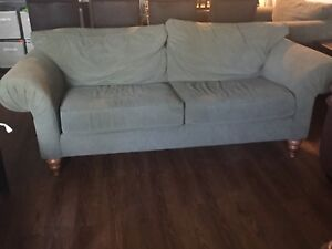 Two green couches for sale