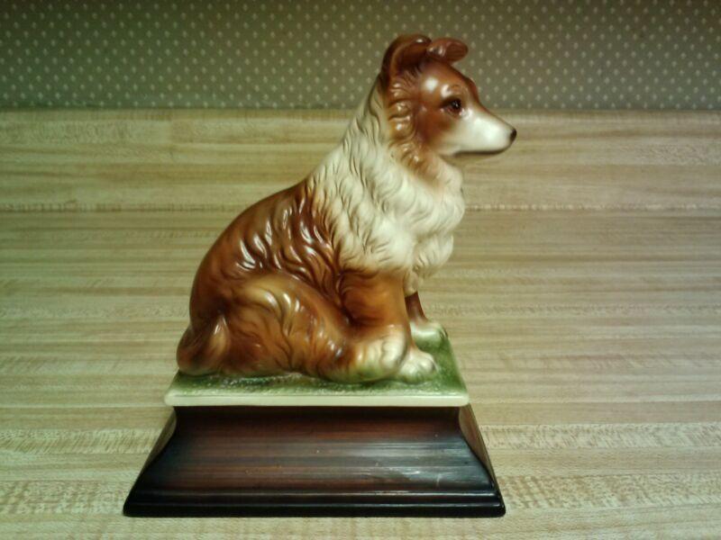 Ucagco Japan porcelain figurine - Sable Collie sitting on pedestal; stamped JHK