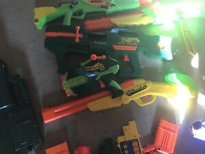 Assortment of nerf guns, mostly nerf but a few buzz bee