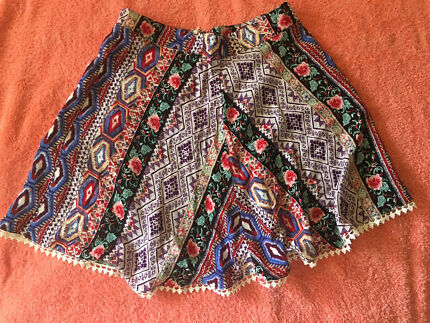 Skirt (Chica  boofi brand) and 3 tops. Women's size 8