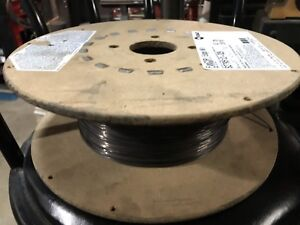 Spool of MIG wire, Hobart FabCOR Edge about half a spool left