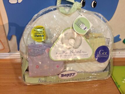 Brand new condition - Boppy pillow with two covers