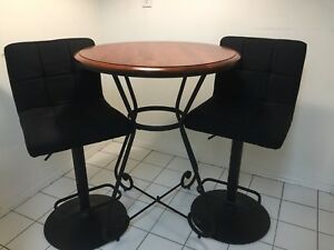 Round table and two chairs