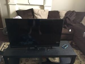 """Love seat and 40"""" RCA flatscreen tv for sale"""