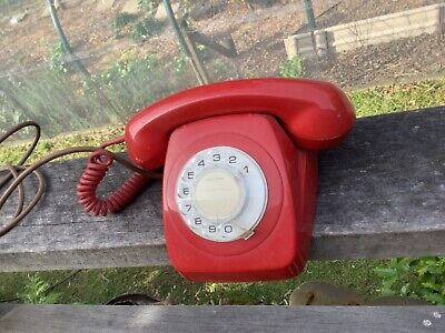 Old red phone, good condition