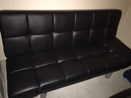 A leather futon sofa that converts into a double bed Hobartville Hawkesbury Area Preview