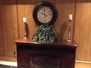 Round black wooden framed white analog wall clock