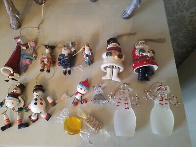 A SELECTION OF VINTAGE JOINTED AND GLASS CHRISTMAS ORNAMENTS