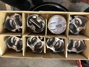 Brand new set of  std pistons and new cam SBC