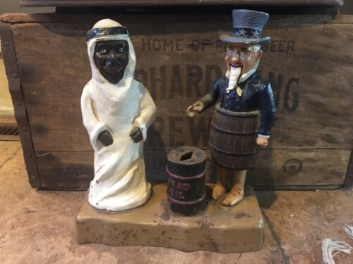 1976 John Wright Penny Bank. Cast iron. Uncle Sam & Arab Oil.