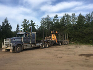 2015 western star and 2015 manac log trailer with 2015 rotobec.
