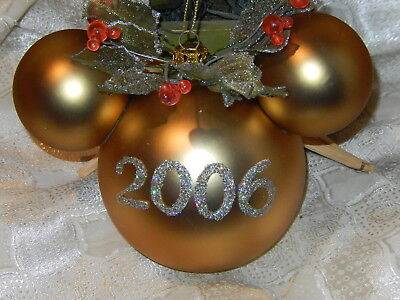 - DISNEY MICKEY HEAD EARS SHIMMERING HOLLY DATED 2006 LARGE GOLD ORNAMENT NIB RARE