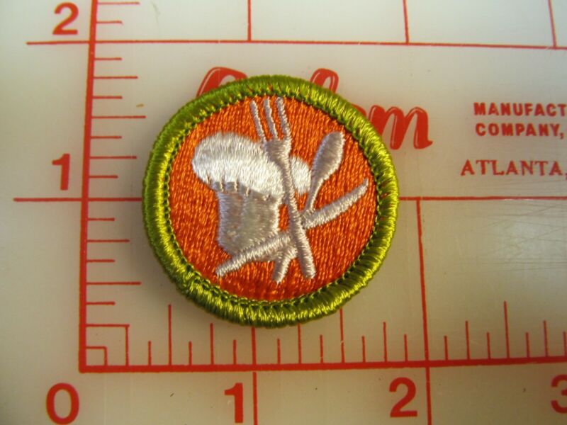 COOKING plastic backed merit badge green border patch (oP)