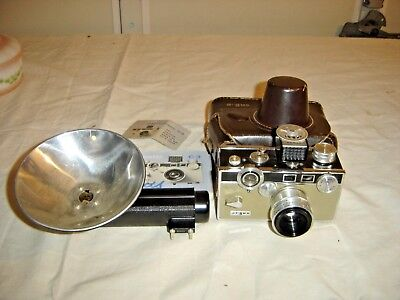 Argus Camera with leather case with manual. 9042