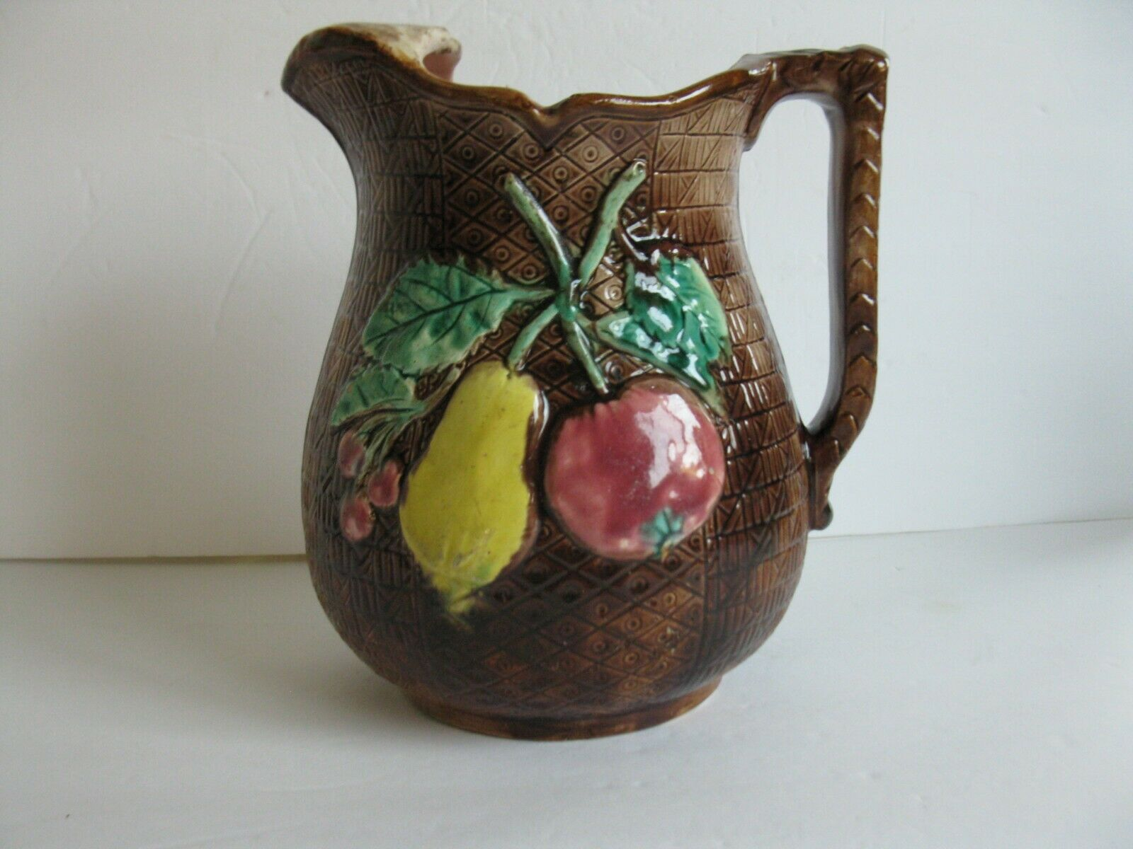 LARGE ANTIQUE TALL MAJOLICA WATER PITCHER WITH FRUIT AND GRAPES. 8 1/2 TALL - $75.00