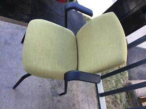 2 green/ yellow office chairs