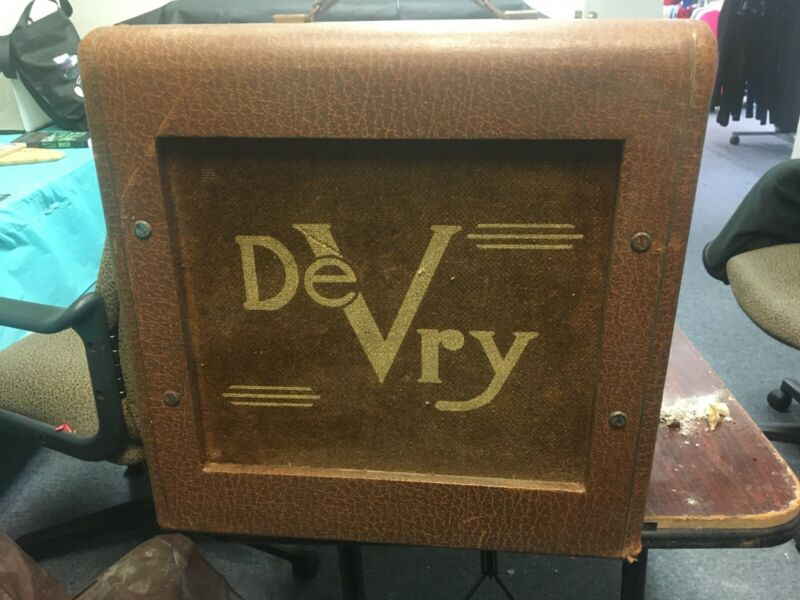 16 mm devry movie projector and speaker with carry bags