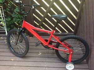 Red kids bike with pump