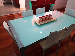 Stylish  Glass top dining table with 6 leather chairs. Mentone Kingston Area Preview
