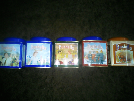 5 Bushells tea tins