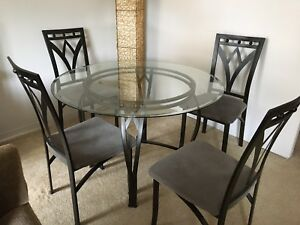 Glass top dining table. Negotiable