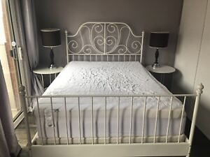 Double bed frame with side tables lamps mattress and box spring