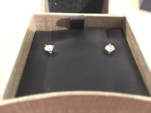 Lady's 14k white gold solitaire earrings Canadian diamonds