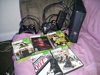 hardly used Xbox 360 200 gig with 2 controllers and 5 games