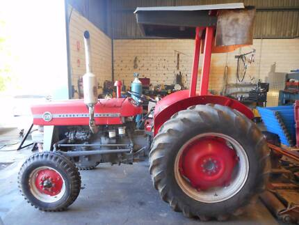 Massie 135 with mower, slasher, grader blade. Priced to sell.