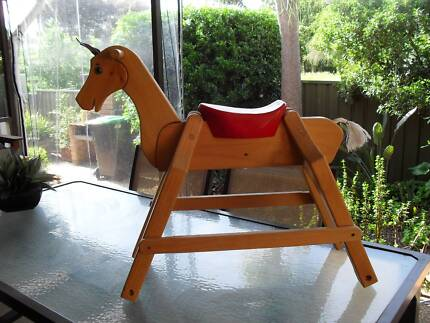 LARGE SOLID WOOD HORSE.