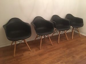 Set of 4 Eames style dinner chairs, black and wood