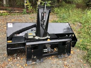 Snow blower attachment for skid steer
