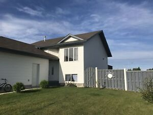BEAUTIFUL HOME WITH FENCED YARD AND GARAGE-WEMBLEY