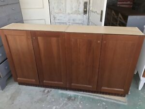 Two Medium maple lower cabinets