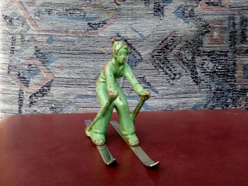 Bronze figure of girl skiing