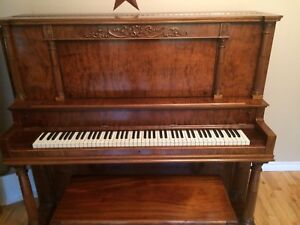 Beautifully refinished piano.
