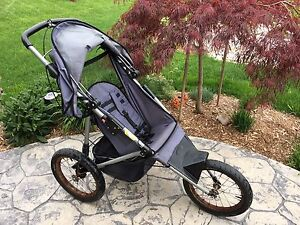 InStep Jogging Stroller, with fixed front wheel in blue grey