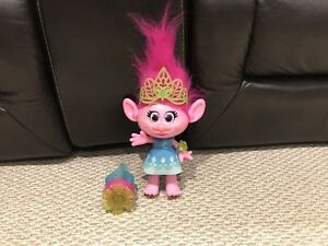 Trolls doll with a personal wrist ban