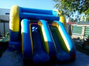 Jumping castle with dble slide for hire
