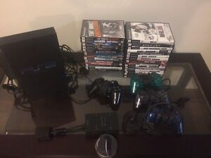 PS2, 4 controllers, multi tap and games