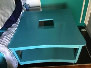 Bright blue large coffee table with glass top