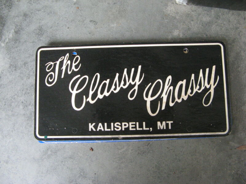 THE CLASSY CHASSY KALISPELL MONTANA MT DEALERSHIP BOOSTER LICENSE PLATE