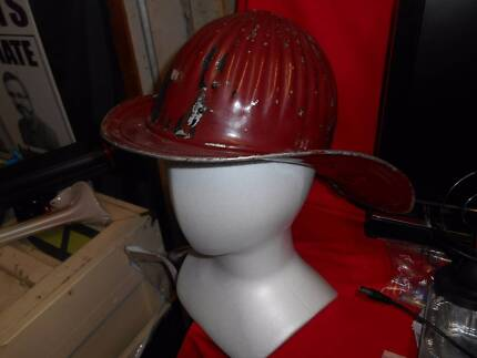 Vintage Cairns red american fire fighters helmet from the 1930s